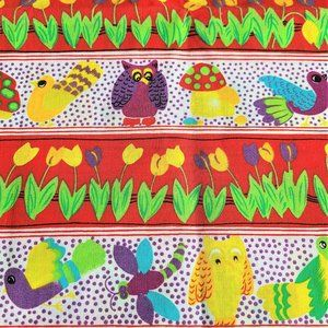 Sewing fabric with birds mushrooms and flowers.
